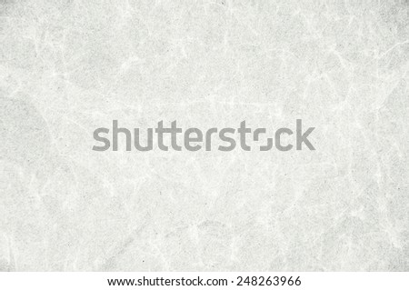 Old black and white crumpled sheet of paper. - stock photo