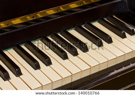 old black and white keyboard of vintage piano - stock photo