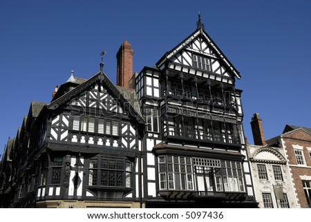 Old black and white tudor building in Chester England showing leaded windows.