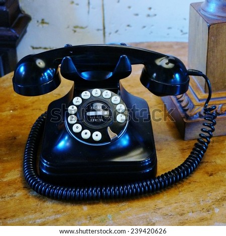 Old black bakelite telephone with rotary dial - stock photo