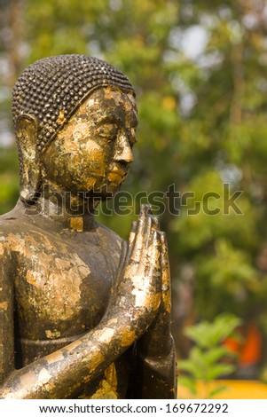old black buddha statue. - stock photo