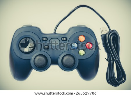 Old black joystick for console video game in isolated background - stock photo