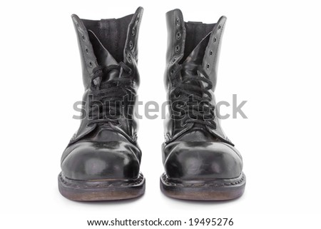 Old black leather work boots isolated on white background
