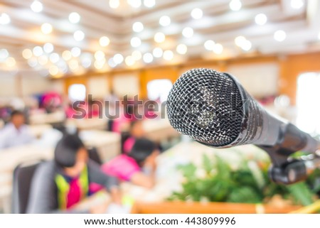 Old Black microphone in conference room - stock photo