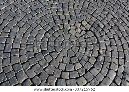Old black pavement as a background - stock photo