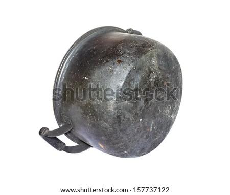 Old black pot on a white background. - stock photo