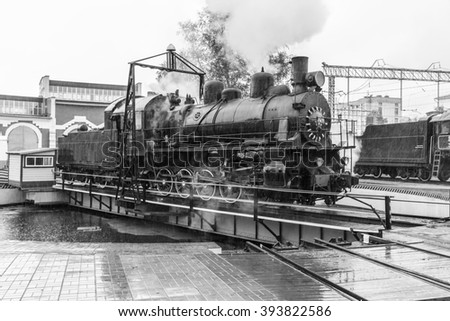 old black steam locomotive and Railway turntable in Russia at the summer at the old railway station - stock photo