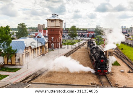 old black steam locomotive in Russia at the summer at the old railway station - stock photo