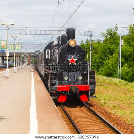 old black steam locomotive in Russia at the summer on a background of blue sky - stock photo