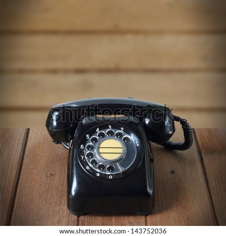 old black telephone - stock photo