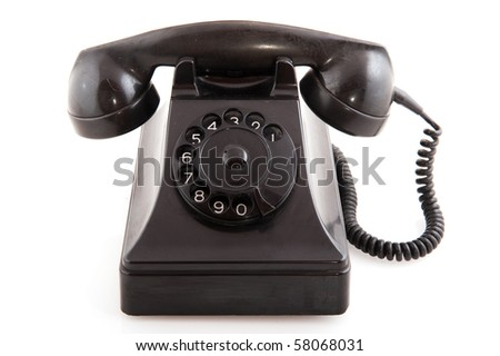 Old black telephone for global communication isolated over white