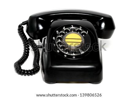 Old black telephone with white background - stock photo