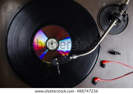 old black vinyl record in the player