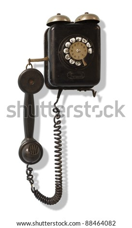Old black wall-mounted telephone - stock photo
