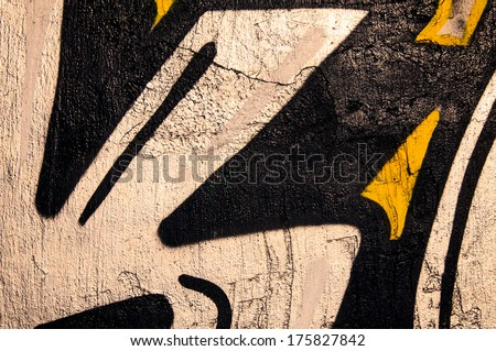 Old black wall with the graffiti - stock photo