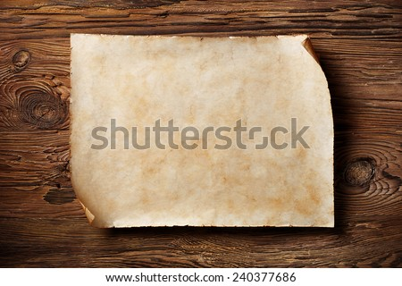 old blank parchment on aged wood background,horizontal - stock photo
