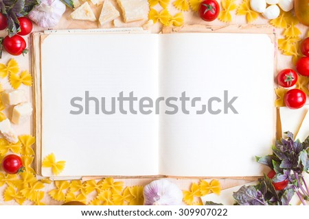 Old blank recipe book with italian food ingredients over rustic wooden table - stock photo