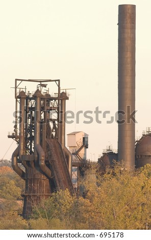 Old blast furnace and smokestack. - stock photo