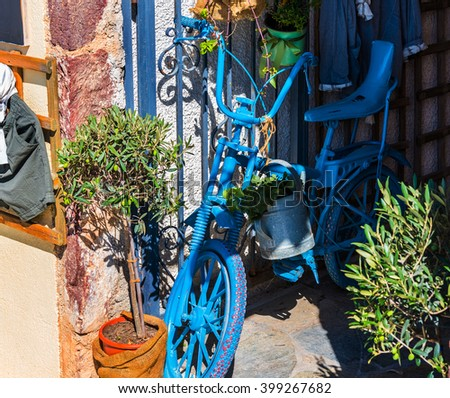 Old blue bicycle as decoration of inner yard on Santorini island, Greece - stock photo