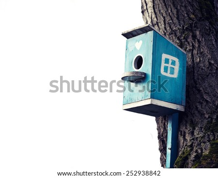 Old blue bird house isolated - stock photo