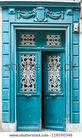 Old blue carving door in Chartres, France - stock photo