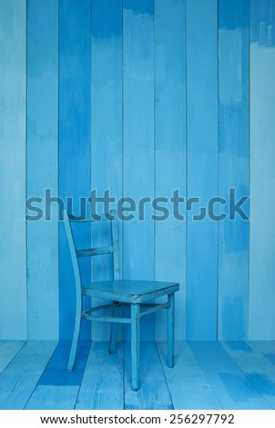 Old Blue Chair Vintage and The wood wall  - stock photo