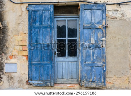 Old blue doors and old wall - stock photo