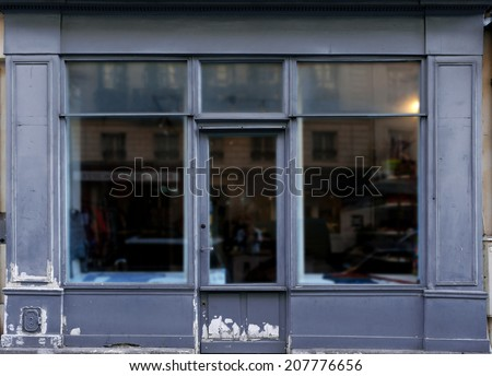 Old blue gray shop front in Paris. - stock photo