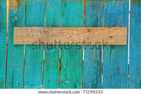 Old board on a wooden fence - stock photo