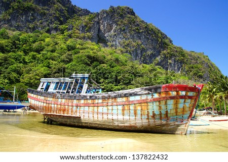 Old boat during low tide. El Nido, Philippines - stock photo