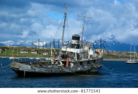 Old boat in harbor of Ushuaia, Argentina - stock photo