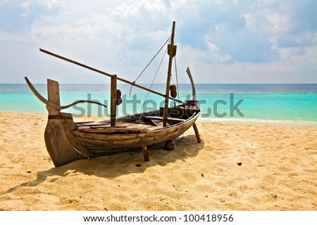 Old boat is on sandy beach, Maldives - stock photo