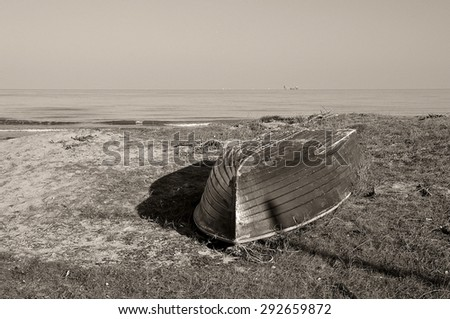 old boat near the sea - stock photo