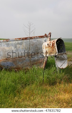 old boat on land with mailbox - stock photo