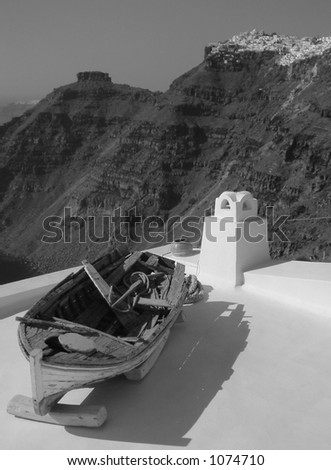 Old boat on roof in Santorini - stock photo