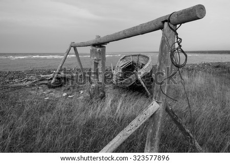 Old boat on the beach. North. Black and white. - stock photo