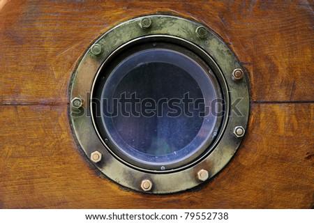 Old boat porthole close-up - stock photo