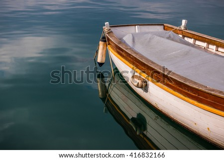 Old boat reflecting in the water