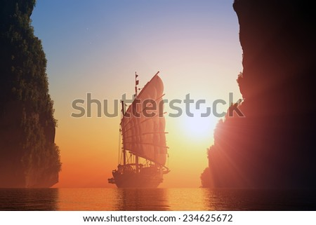 Old boat with sails on a colorful background lanshafty. - stock photo