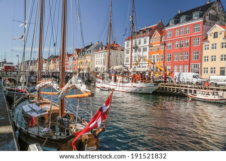 Old boats and houses in Nyhavn in Copenhagen - stock photo
