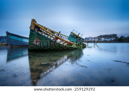 Old boats in their final resting place at Hooe Lake in Plymouth, Devon - stock photo