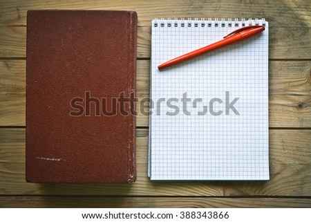 old book and a clean notebook - stock photo