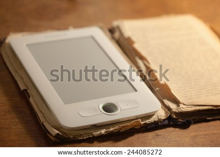 Old book and a modern ebook together - stock photo