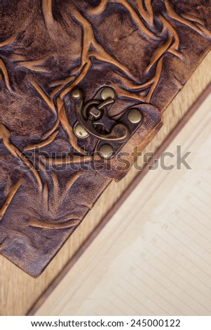 Old book and diary on wooden table - stock photo