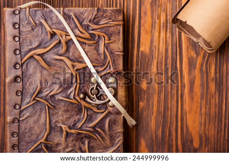 Old book and letter on wooden table - stock photo