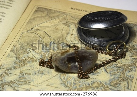 old book and old watch - stock photo