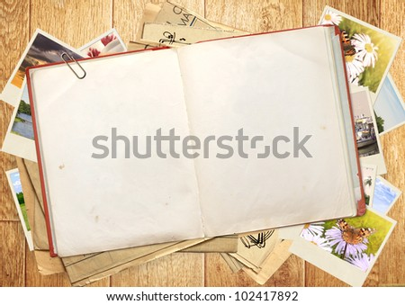 Old book and photos. Objects over wooden plank - stock photo