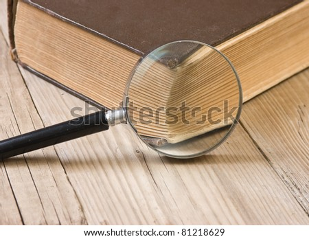 old book bible and magnifying glass - stock photo