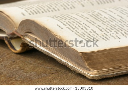 Old book in brown cover close up - stock photo
