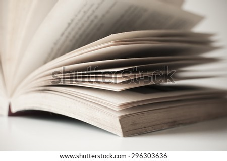 Old book open on white table - stock photo
